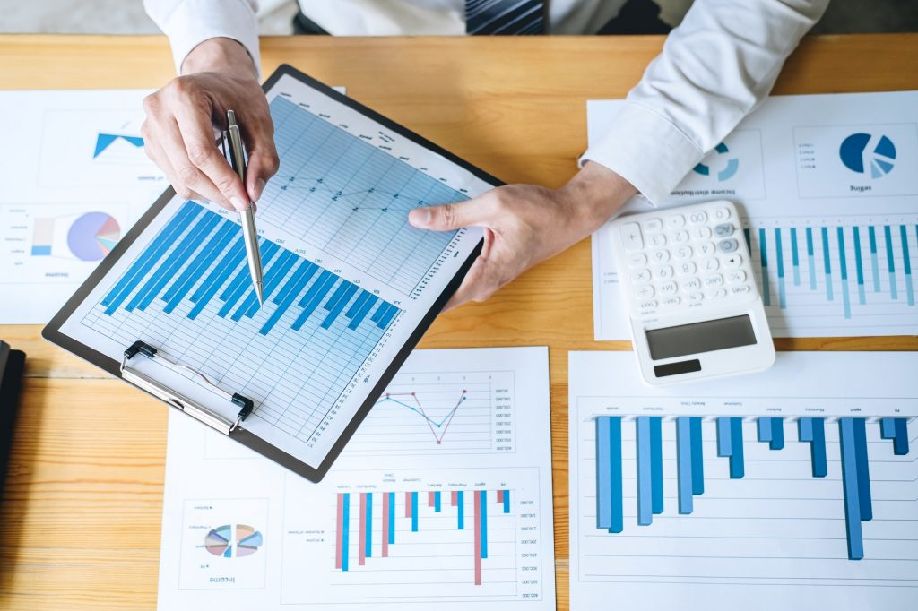 Businessman accountant working analyzing and calculating expense financial annual financial report