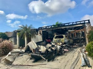 House fire caused this garage to be burned along with the car inside. Insurance is necessary.