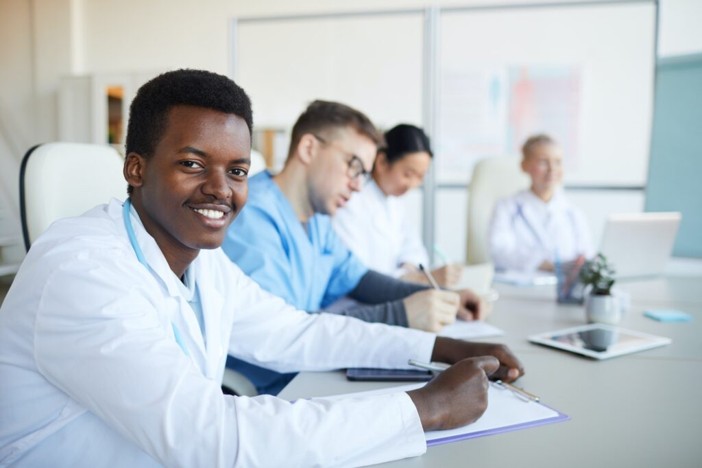 Young African Doctor Smiling in Internship
