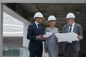 Management Discussing Construction on Site