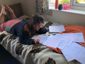 Young woman, university student, studying at home.