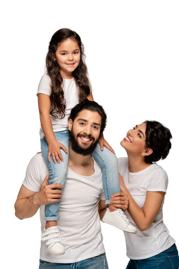 happy latin father carrying on shoulders cute daughter near happy wife isolated on white