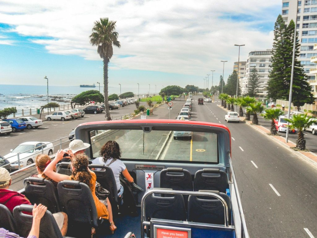 tourists on double decker sightseeing bus in Cape Town, South Africa