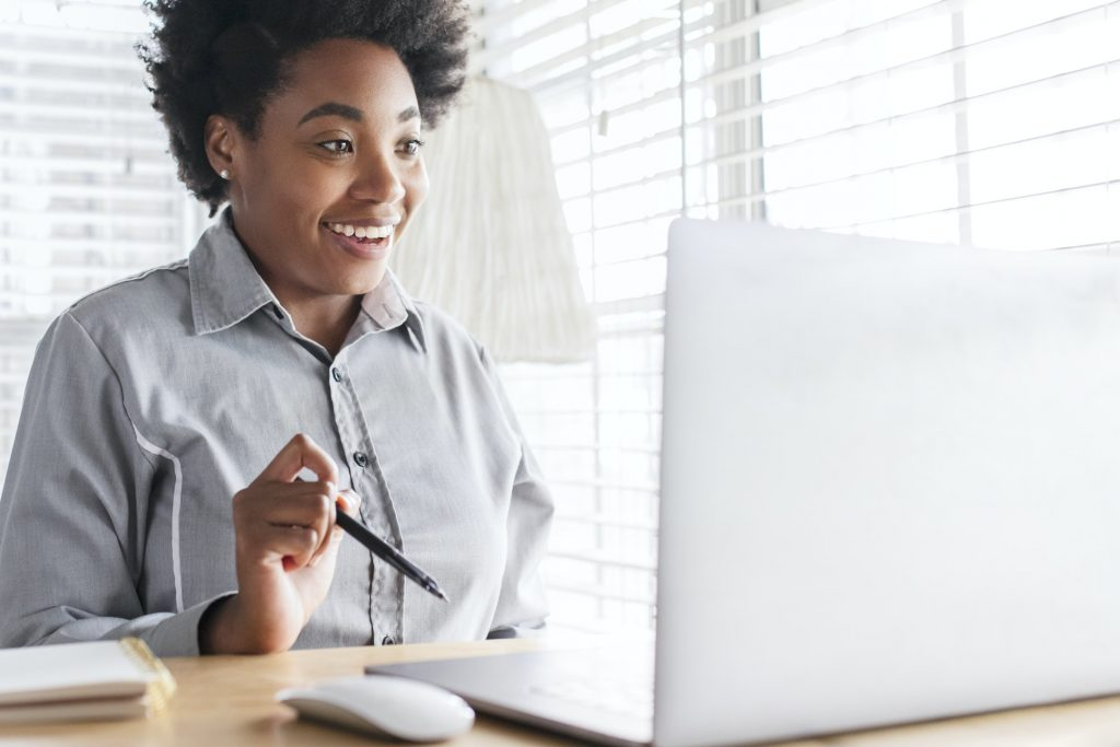 Woman having an online class meeting through e-learning system